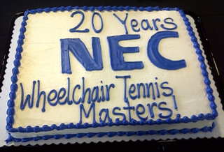 A cake commemorating The 20th NEC Wheelchair Tennis Masters presented by The International Tennis Federation