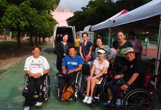Wheelchair tennis athletes and volunteers (as interpreters) at NEC Taiwan